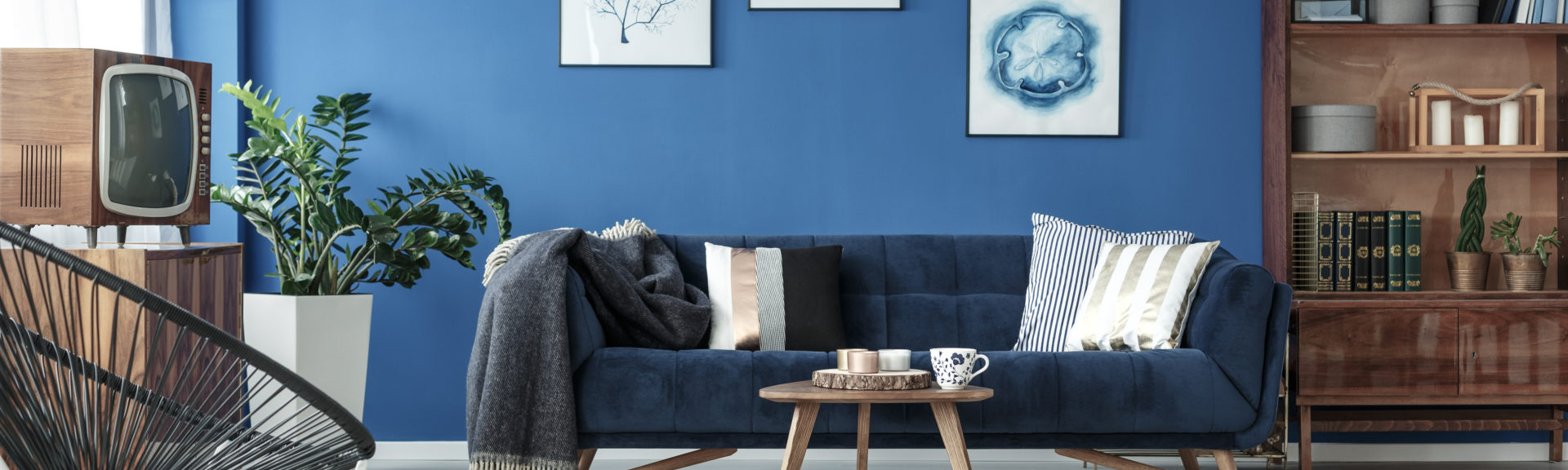 Modern livingroom with blue painted wall